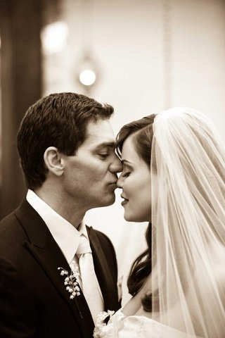 black-and-white-photo-of-groom-kissing-brides-nose