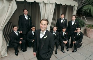groomsmen-outside-in-black-tuxedos-with-bow-ties