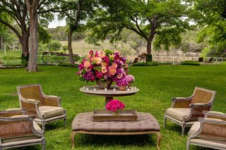 outdoor-wedding-lounge-area-with-aged-wood-chairs-and-furniture