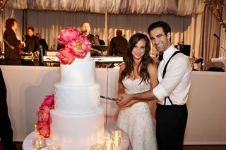 bride-and-groom-cutting-white-wedding-cake