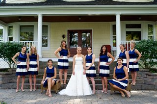 bridesmaids-in-blue-sleeveless-dresses-white-stripes-on-skirts-bride-in-strapless-vera-wang-gown
