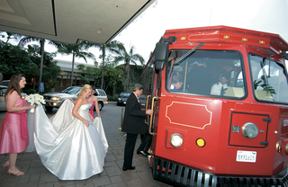 maid-of-honor-helps-bride-into-transportation