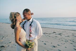 casual-bride-and-groom-on-san-juan-capistrano-beach