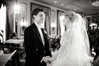 black-and-white-photo-of-bride-and-groom-at-ceremony