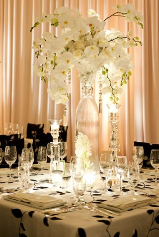 glass-vase-with-white-orchids-and-roses-and-hanging-crystals