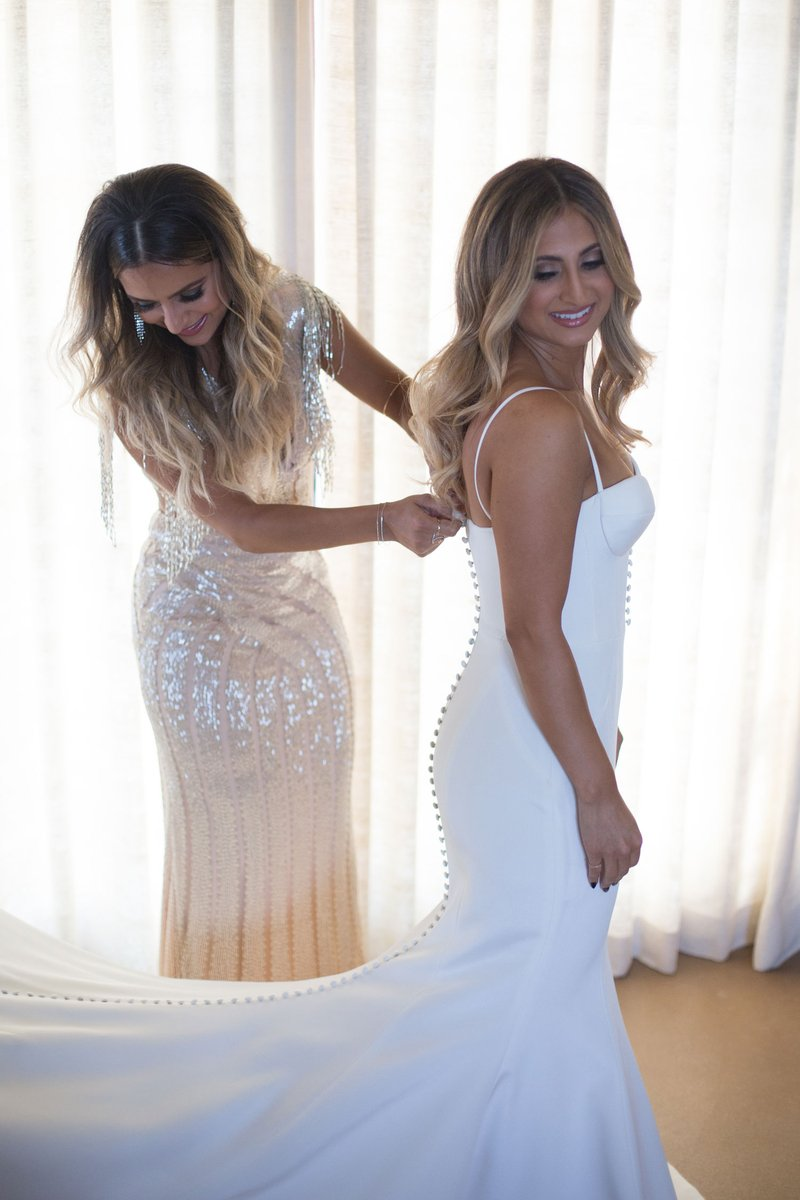 Bridesmaid Helping Bride Button Dress