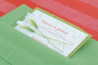 wedding-menu-on-white-stationery-in-orange-print-with-green-background