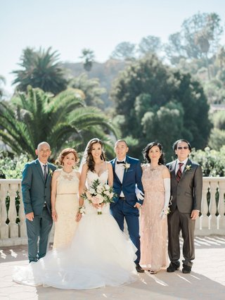 wedding-portrait-bride-and-groom-asian-american-with-parents-in-evening-gowns-gloves-suits