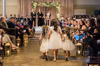 three-flower-girls-in-white-dressed-walk-down-aisle-jewish-wedding