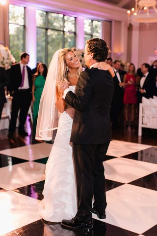bride-in-anne-barge-wedding-dress-fingertip-veil-with-black-and-white-checker-dance-floor