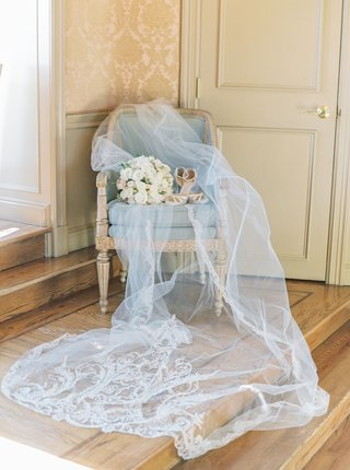 light-blue-antique-chair-beautiful-veil-with-monogram-and-embroidery-bouquet-with-high-heels