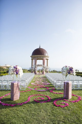 pink-and-purple-flower-petals-on-grass-aisle