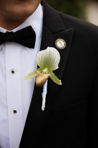 single-large-white-green-and-gold-orchid-as-boutonniere