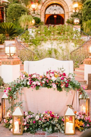 wedding-reception-spanish-style-venue-ranch-white-settee-sweetheart-table-greenery-pink-flowers