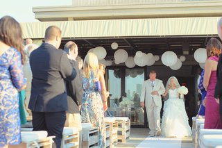 bride-walks-down-white-aisle-with-father-of-bride
