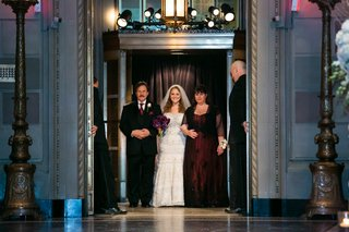 bride-in-kleinfeld-bridal-wedding-dress-with-parents-in-deep-purple-burgundy-wedding-attire