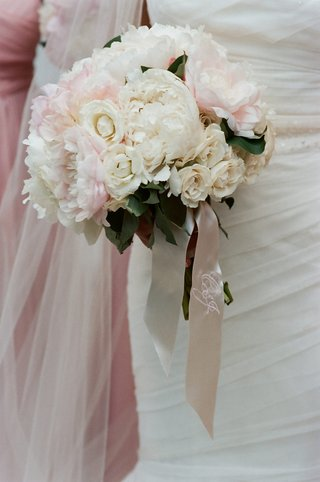 flowers-tied-together-with-embroidered-ribbon
