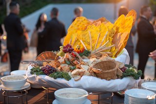 spread-of-fruit-and-bread-at-wedding-cocktail-hour