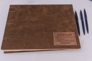suede-guestbook-with-bronze-plaque-and-celebrity-names