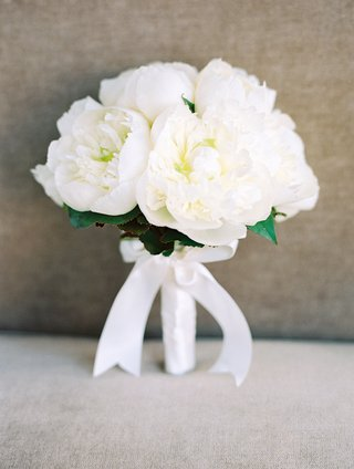 brides-bouquet-with-white-peony-flowers-wrapped-with-satin-ribbon