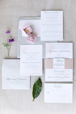 invitation-suite-with-pink-rose-print-grey-lettering-and-envelope-belly-band
