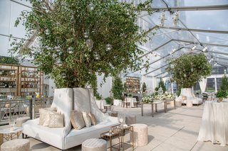beautiful-cocktail-hour-lounge-area-white-settees-trees-tables-neutral-color-palette