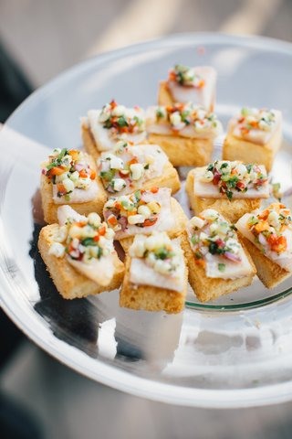wedding-reception-cocktail-hour-food-crostini-bread-with-slice-of-meat-or-cheese-and-fresh-corn-sals