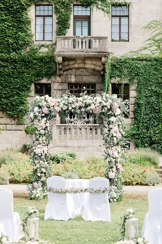 wedding-ceremony-in-germany-castle-venue-outdoor-chandelier-pink-white-flowers-sage-greenery-white