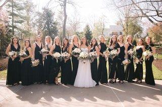 wedding-photo-bride-in-reem-acra-wedding-dress-bridesmaids-in-mismatched-black-dresses-long