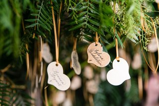 wedding-reception-escort-card-display-live-tree-with-wood-heart-shape-escort-cards-table-numbers