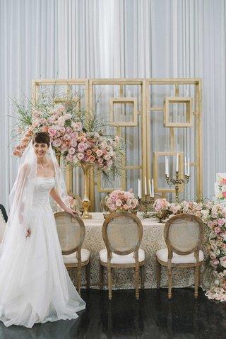bride-a-line-jinza-gown-veil-taupe-tablescape-detailed-linen-blush-florals-cascading-runner