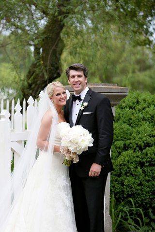 smiling-bride-and-groom-strapless-vera-wang-wedding-gown-black-and-white-suit