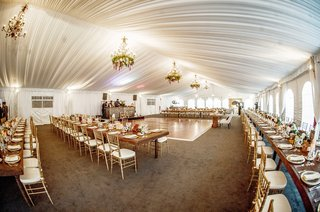 wedding-reception-space-with-gold-chiavari-chairs-and-white-drapery-ceiling