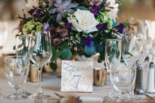 paper-table-number-made-to-look-like-mercury-glass-in-front-of-purple-floral-centerpiece