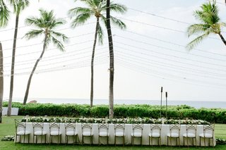 wedding-reception-on-the-big-island-in-hawaii-chameleon-chair-collection-gold-chairs-low-centerpiece