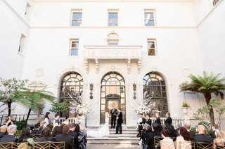 james-leary-flood-mansion-san-francisco-wedding-ceremony-guests-seated-during-vows