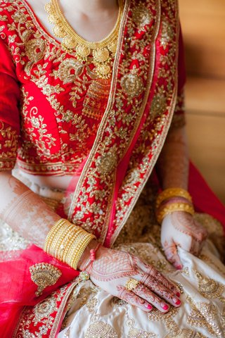 japanese-bride-in-indian-wedding-attire-henna-lehenga-red-gold-embroidery-jewels