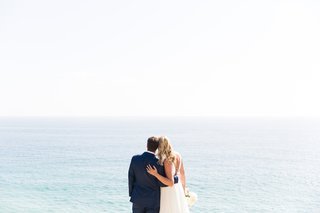 bride-and-groom-looking-out-to-the-ocean-beach-wedding-malibu-wedding
