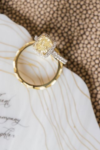 yellow-diamond-engagement-ring-with-white-diamond-halo-and-setting