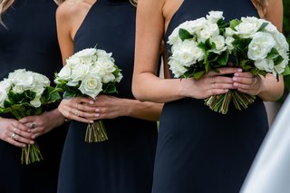 wedding ceremony bridesmaids in black dresses with white rose bouquets nosegays