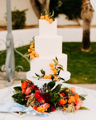 wedding cake white fondant smooth layers kumquat pink red flowers thistles and yellow decor