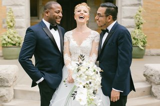 bride-in-hayley-paige-laughes-with-two-bridesmen-in-navy-tuxedos