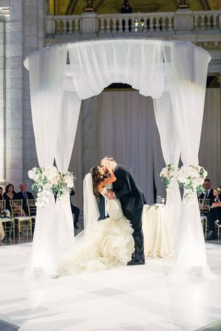 A Charming Fete Couple Kissing at Ceremony mitchell schwartz
