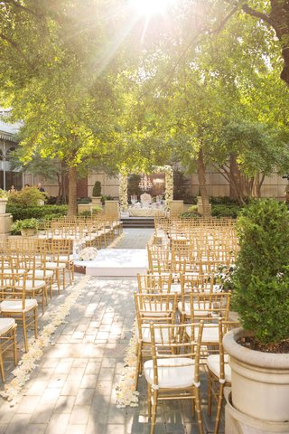 gold-white-cushions-rose-aisle-low-hanged-branches-trees-dallas-texas-flower-arch