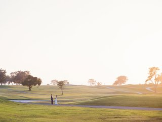 bride-and-groom-on-golf-course-at-the-lodge-at-torrey-pines-in-san-diego-la-jolla-area-destination