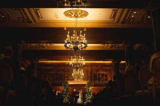 wedding-ceremony-at-the-willard-in-washington-dc-chandelier-wood-paneling-ceiling-greenery-chuppah