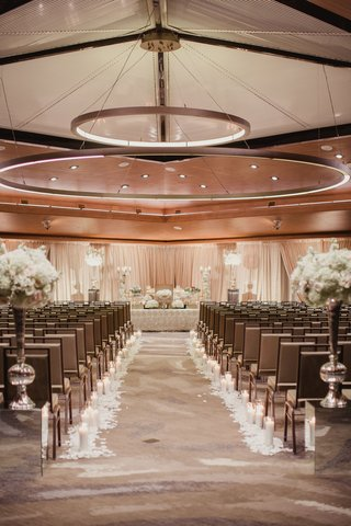 ballroom-wedding-ceremony-persian-wedding-with-round-lights-overhead-square-chairs-white-flowers