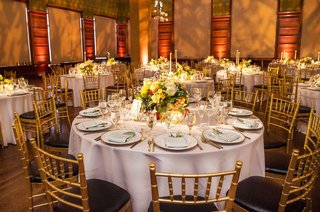 wedding-reception-gold-black-chairs-gold-room-museum-wedding-low-centerpiece-yellow-flowers-candles