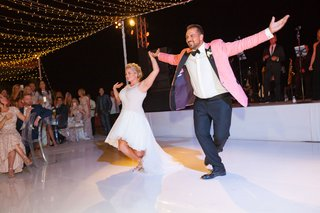 bride-in-mark-zunino-high-low-wedding-dress-groom-in-salmon-tuxedo-jacket-choreographed-first-dance
