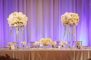 wedding-head-table-two-centerpieces-with-small-centerpiece-in-the-middle
